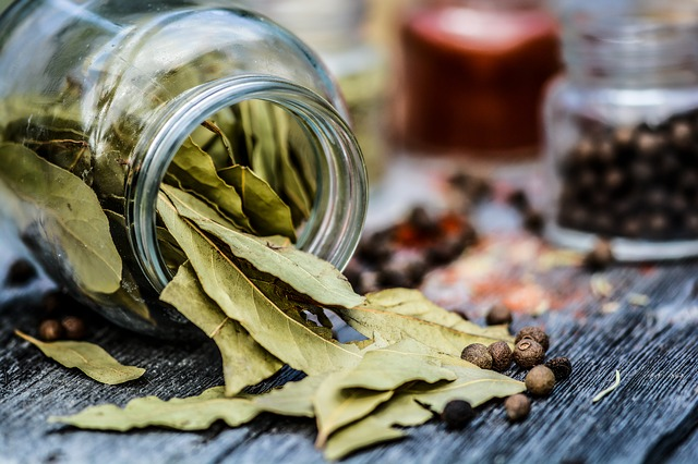 bay leaves scattered on wooden table to keep pests away